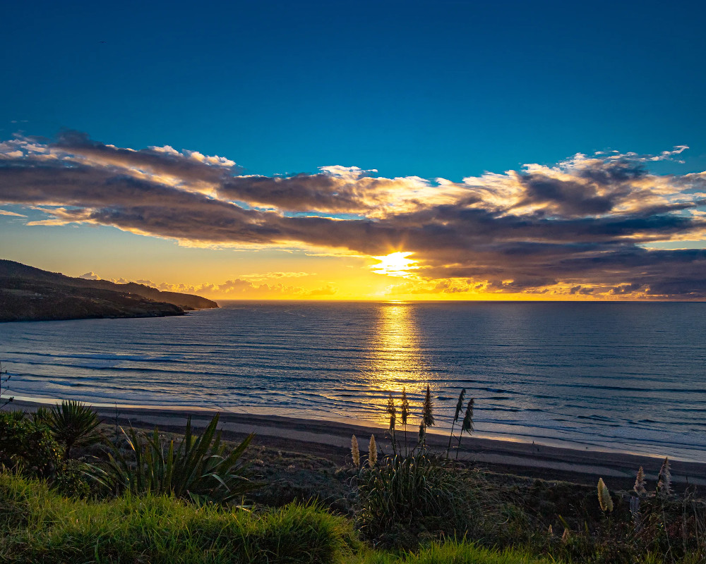 Raglan beach sunset