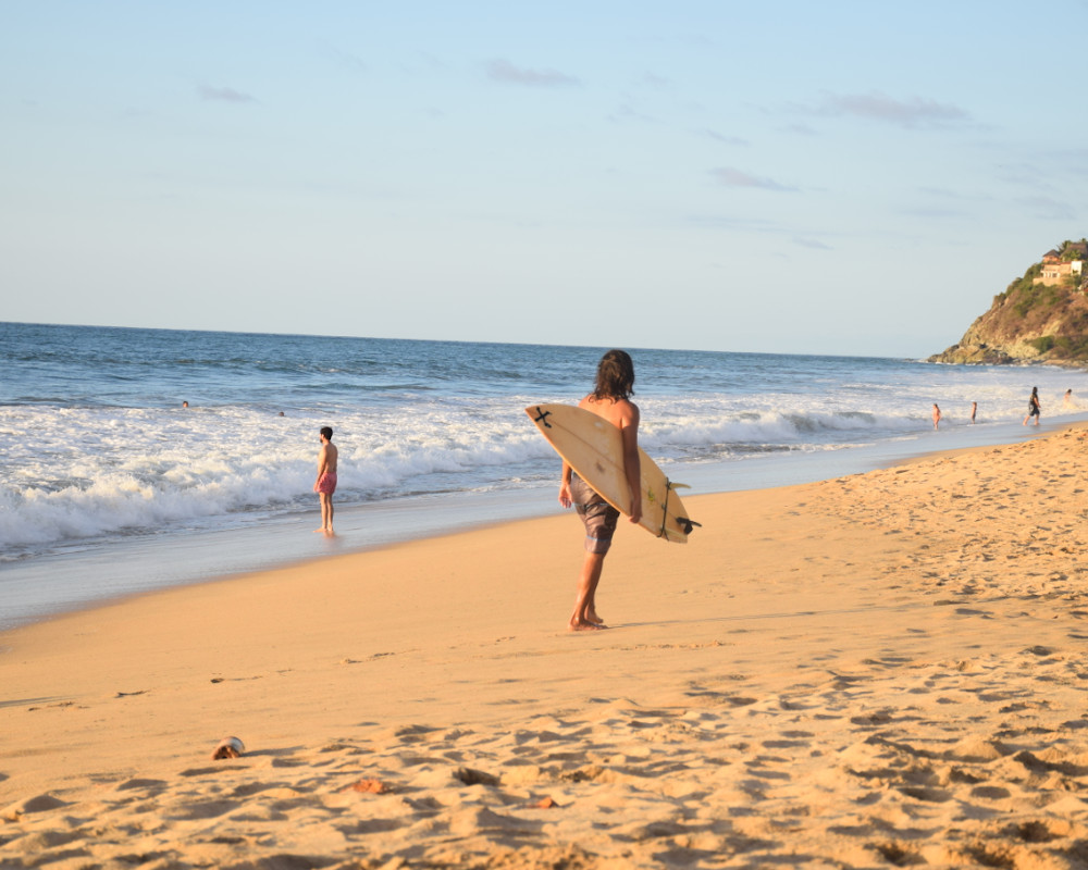 Surfer on the beach in San Pancho