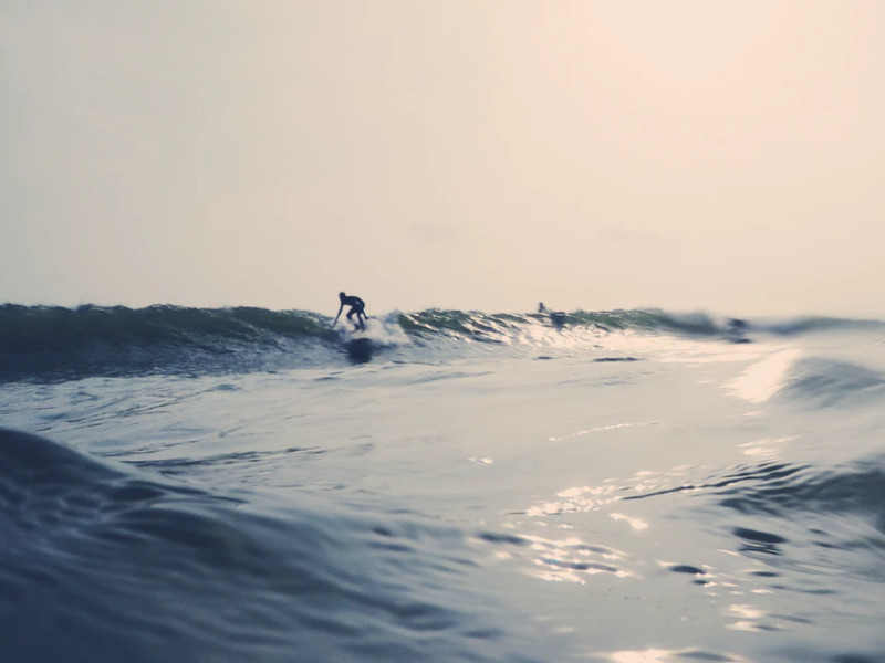 A surfer in Weligama