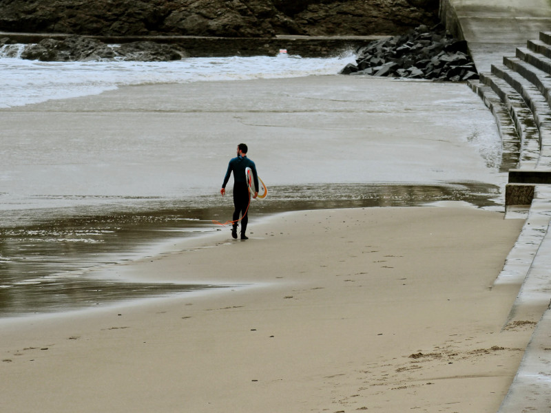 Surfer in France in the winter