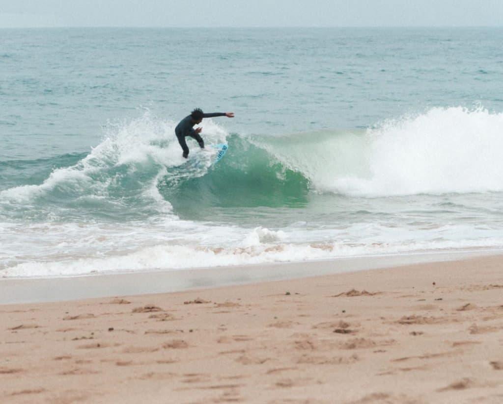 Surfer on a beach near Cadiz