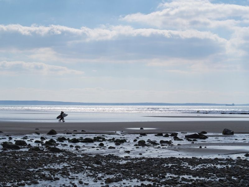 Surfers on the beach in Pembrokeshire
