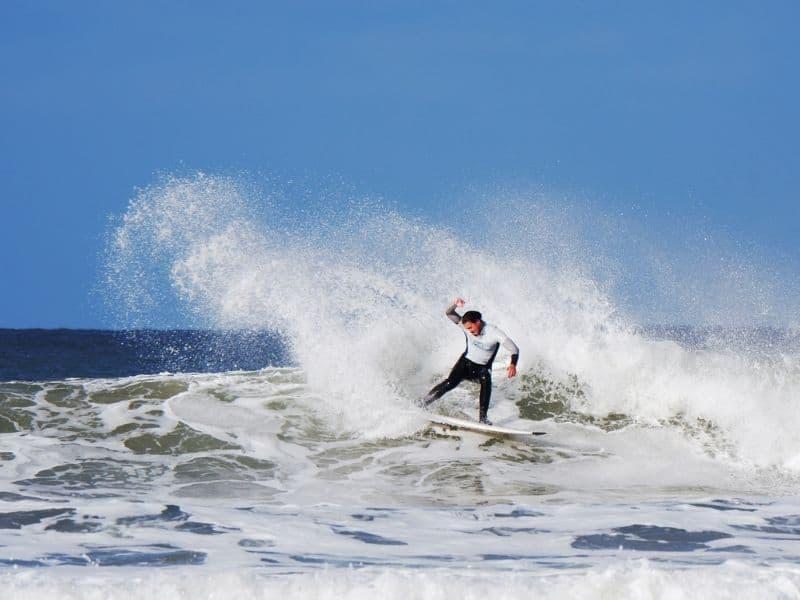 A surfer in Putsborough, Devon